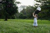 girl chasing butterflies