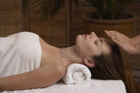woman receiving reiki massage