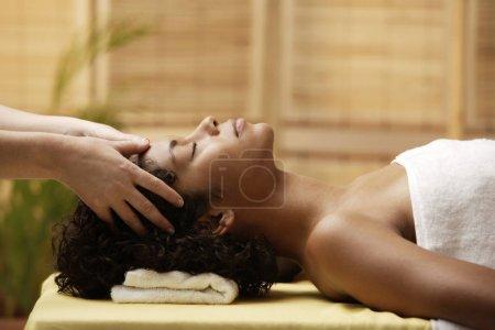 woman having her head massaged