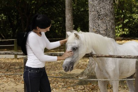 woman with white horse