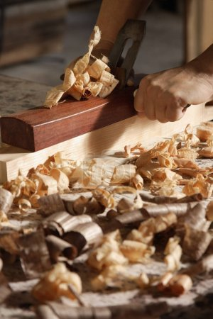 carpenter using a block plane.