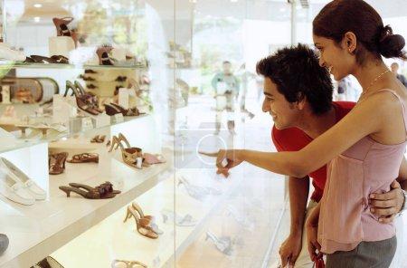 Couple outside shoe shop