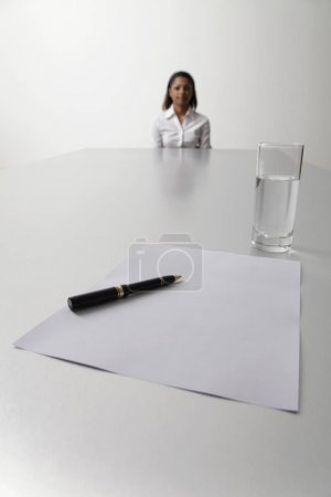 Young woman sits at end of the table