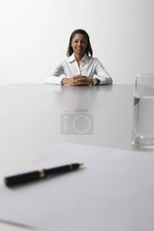 young woman sitting at end of the table