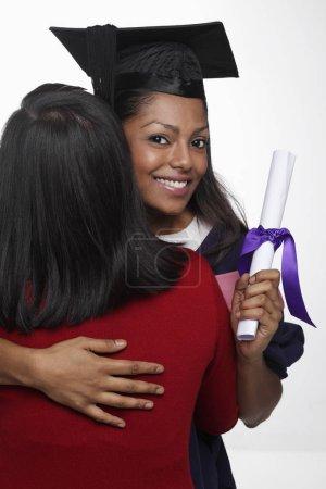 Young woman wearing graduation cap