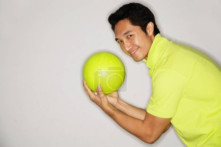 Man holding bowling ball
