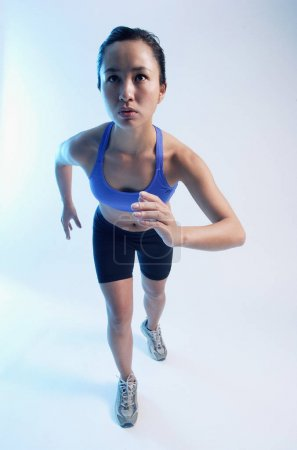Woman in running position