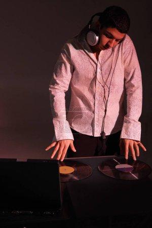 man working as DJ