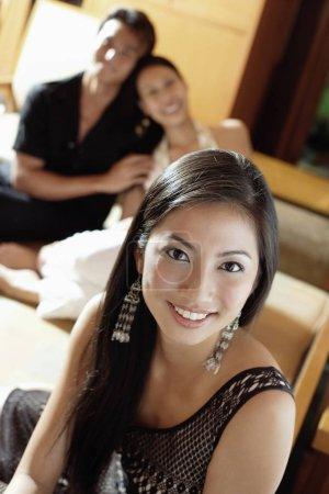 Woman smiling, looking at camera