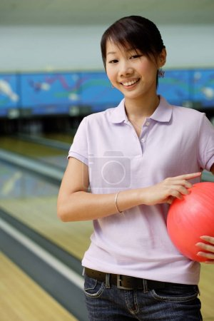 Woman at bowling alley