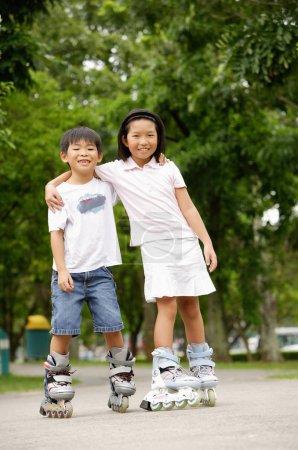 asian Children rollerblading