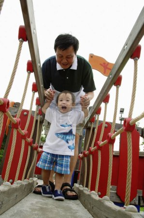 Father with young son in playground