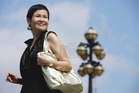 Mature woman carrying shoulder bag