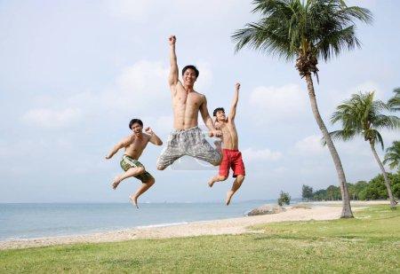 men jumping in air