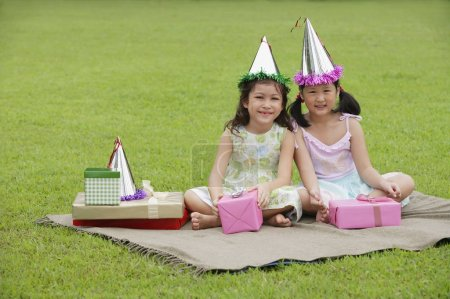 girls wearing party hats