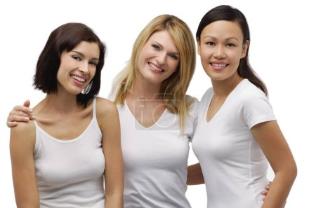 Three young woman wearing white