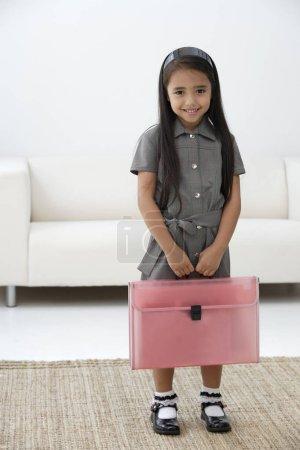 girl dressed in school uniform