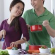 Asian Couple cooking together...
