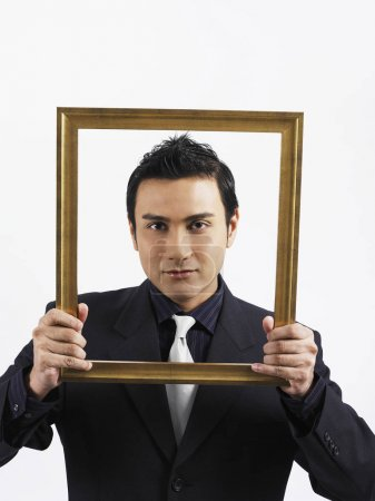 Man holding up a empty photo frame