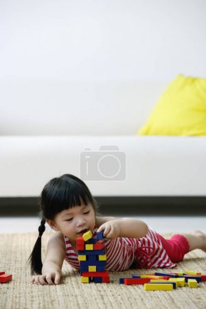 A small girl plays