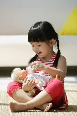 girl plays with a doll