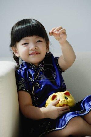 A small girl in blue silk cheongsam