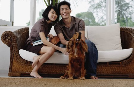 A young couple with a dog