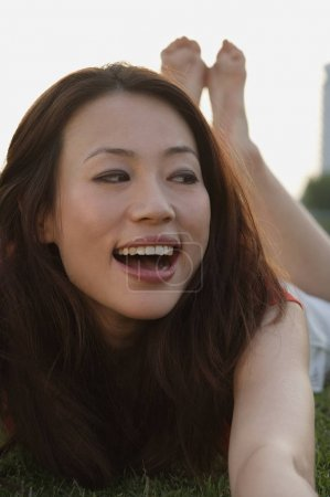 Woman laughing and looking sideways