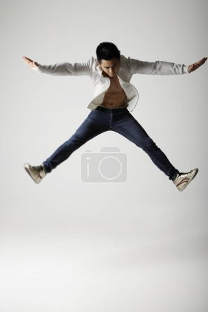 Man jumping and spreading arms