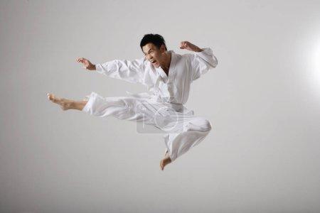 Man doing a flying kick
