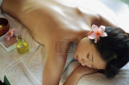 woman lying on massage table