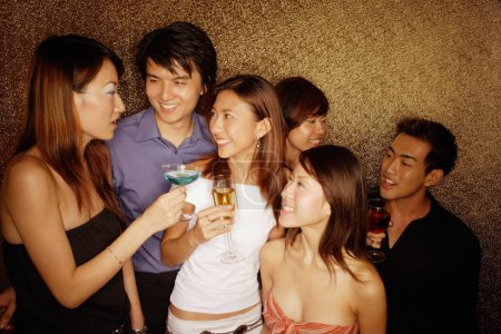 Young adults holding drinks