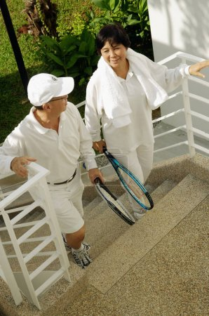 Couple holding tennis rackets