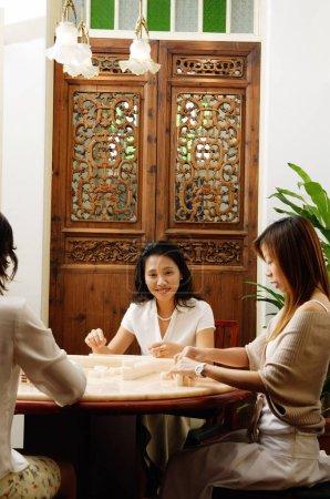 women together playing mahjong