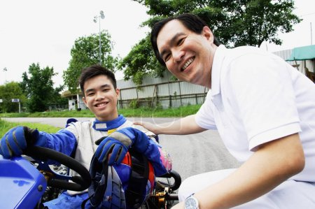 Man in go-cart with father
