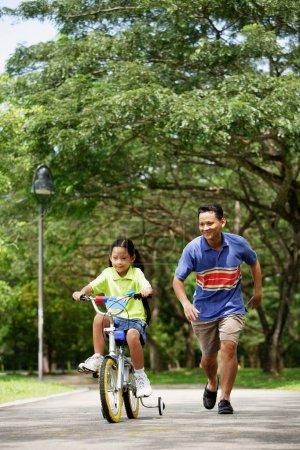 Girl cycling away