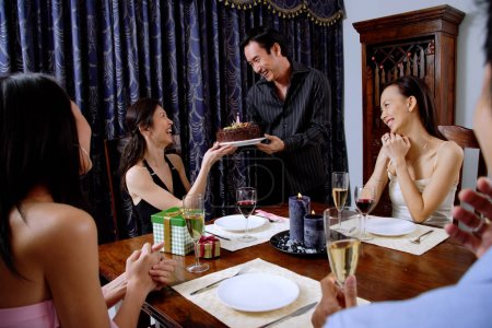 Adults at a dinner party