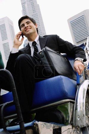 Businessman sitting in trishaw