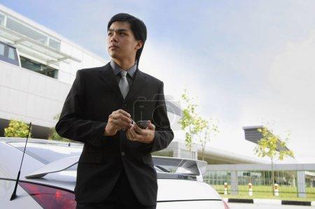 young Businessman near car
