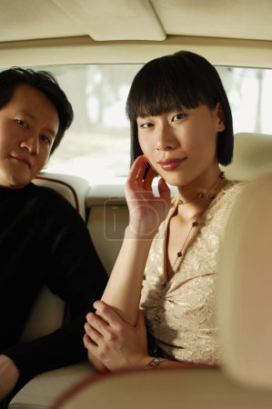 Couple sitting in car interior