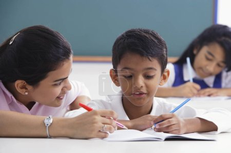 teacher helps student with schoolwork