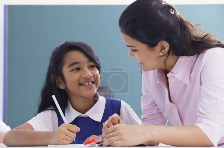 teacher and student smile