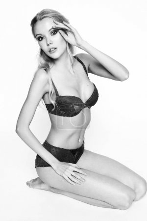 blonde girl pose in lingerie