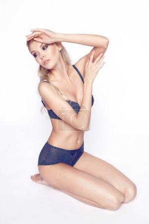 blonde girl pose in blue lingerie