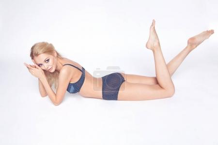 blonde girl pose in blue lingerie