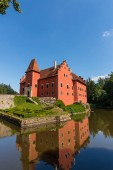 Nice romantic castle with red color in the middle of lake