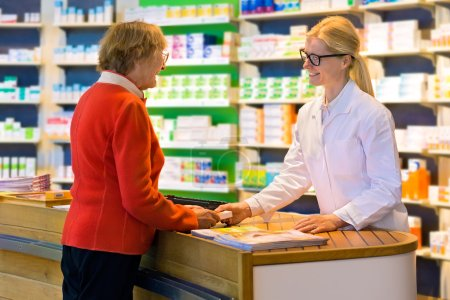 pharmacist giving prescription drugs