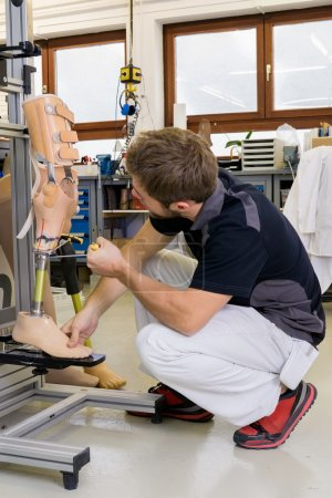 Technician working on prosthetic leg