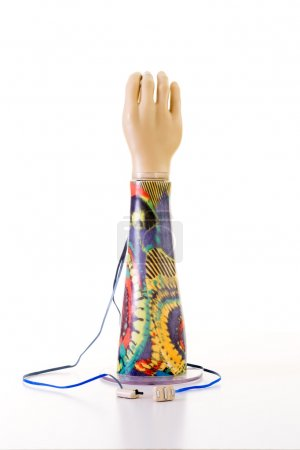 Photo for Still Life of Electronic Prosthetic Arm with Psychedelic Patterns on Forearm  in Studio with White Background - Royalty Free Image