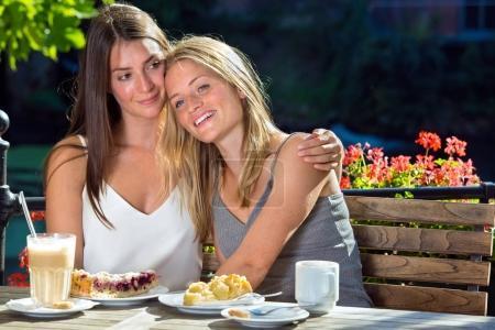 female friends sitting in cafe